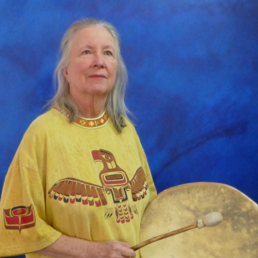 Glenda Taylor with drum 4 2017; OneAndAllWisdom.com CC2.0